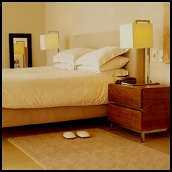 bed and nightstand with slippers