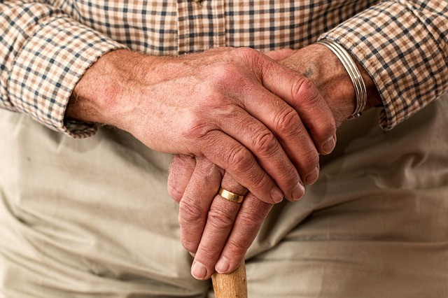 Senior male hands with cane